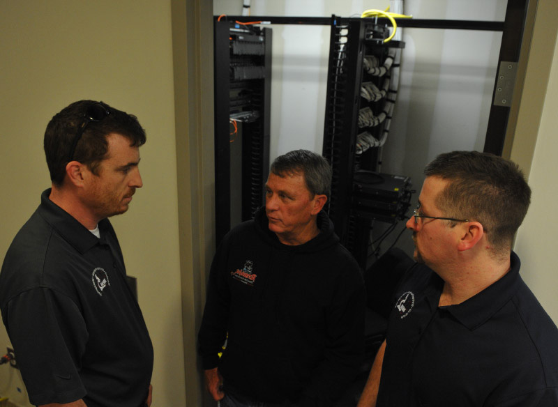 Armada Disaster Solutions employees in Information Technology closet